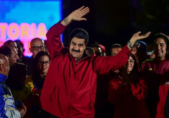 Venezuelan President Nicolas Maduro -- wearing the red associated with the socialist revolution started by his late mentor, Hugo Chavez -- celebrates Sunday's results