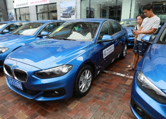 A company in the northeastern Chinese city of Shenyang is rolling out a first batch of royal blue BMWs for sharing -- where users scan a QR code with their mobile phones