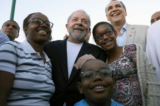 Former Brazilian president Luiz Inacio Lula da Silva poses with supporters during his bus tour of northeastern Brazil