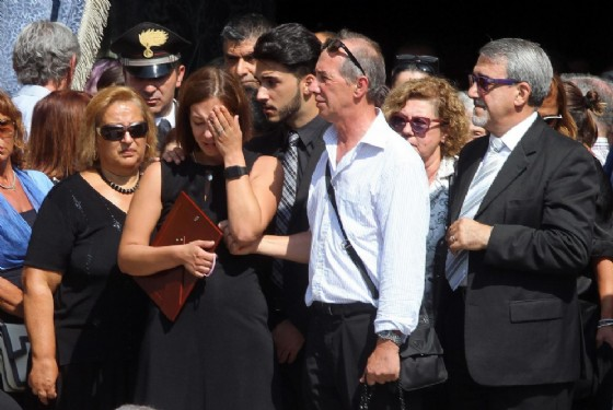 La compagna di Bruno Gulotta, Martina, al termine dei funerali nella basilica di San Magno a Legnano