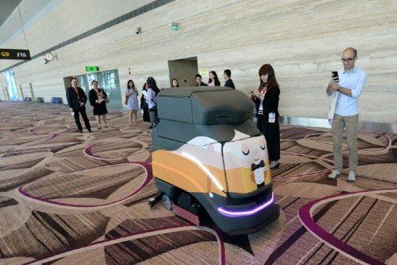 An automatic robot vacuum cleans the floor at Singapore's highly regarded Changi airport