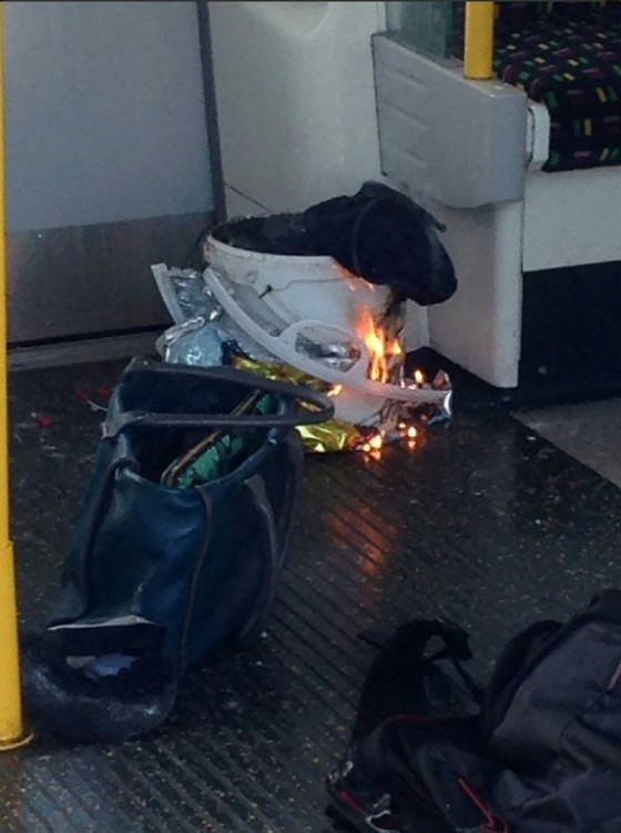 A handout picture obtained from twitter user @RRigs shows a white container burning inside a London Underground train carriage. British police are treating the incident as an act of terrorism.