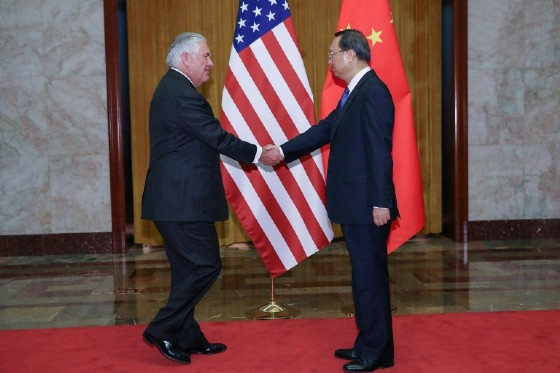 US Secretary of State Rex Tillerson shakes hands with Chinese State Councilor Yang Jiechi before their meeting at the Great Hall of the People