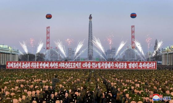 Photographs showed thousands of tightly packed soldiers and people applauding on Pyongyang's Kim Il-Sung square, which was decorated with large portraits of the North's late leaders.