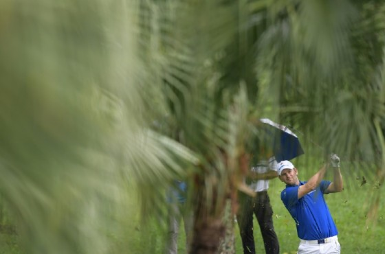 Team Europe's Bernd Wiesberger plays a shot in the fourball match against Team Asia's Li Haotong and Nicholas Fung