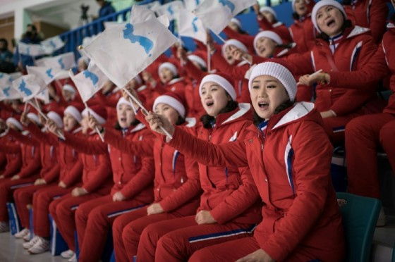 North Korean cheerleaders wave the unification flag as the joint Korean team goes down 8-0 against Sweden.