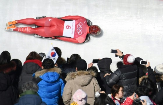 South Korea's Yun Sungbin speeds towards the gold medal watched by an army of fans in the men's skeleton during the Pyeongchang 2018 Winter Olympics on Friday.