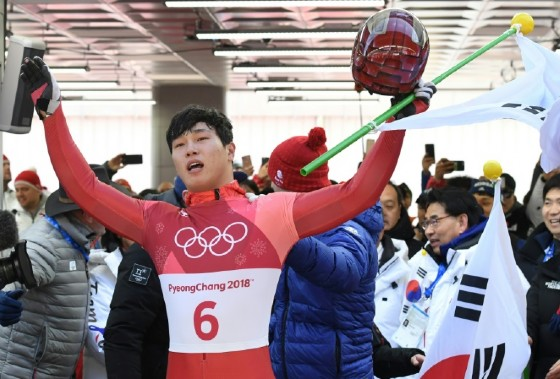 South Korea's Yun Sungbin celebrates getting the gold in the mens's skeleton during the Pyeongchang 2018 Winter Olympic Games on Friday