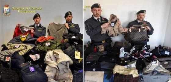 Fvg: la Guardia di Finanza sequestra 21 mila articoli di abbigliamento contraffatti e 21.700 euro (© Guardia di Finanza)