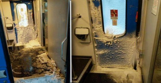 Treno invaso dalla neve a Porta Nuova