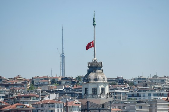 A Turkish flag flies at half-mast from the Maiden Tower in Istanbul