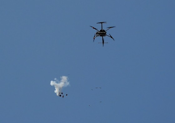 An Israeli drone drops tear gas canisters to disperse Palestinian protesters near the border east of Gaza City on May 15, 2018