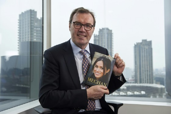 British journalist and writer Andrew Morton, pictured in April 2018, holds a copy of his biography of Meghan Markle