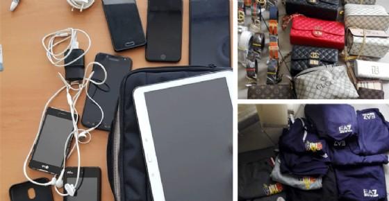 Blitz a Porta Palazzo e Barattolo: sequestrati telefoni rubati, borse e capi d'abbigliamento falsi