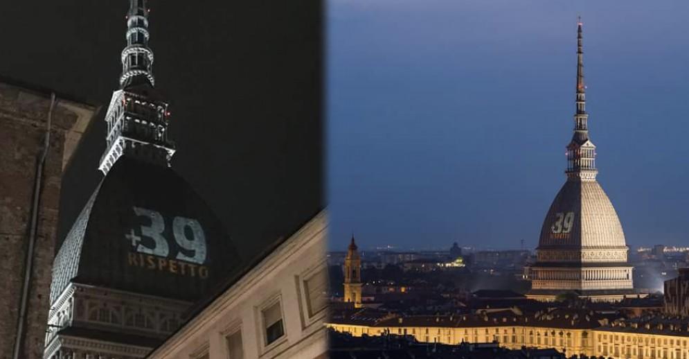La scritta «+ 39 RISPETTO» sulla Mole Antonelliana