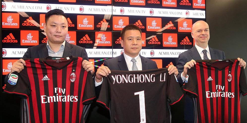 Li Yonghong con Han Li e Marco Fassone