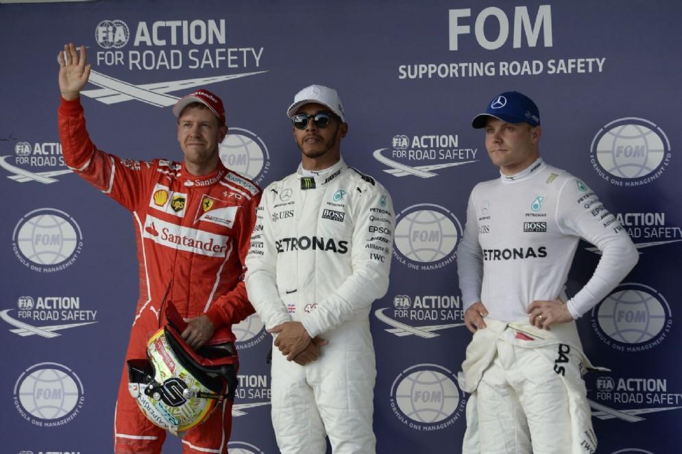Il podio delle qualifiche del GP degli USA: Lewis Hamilton, Sebastian Vettel e Valtteri Bottas