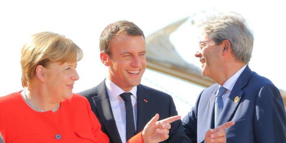 Angela Merkel, Emmanuel Macron e Paolo Gentilo al vertice europeo sull'immigrazione