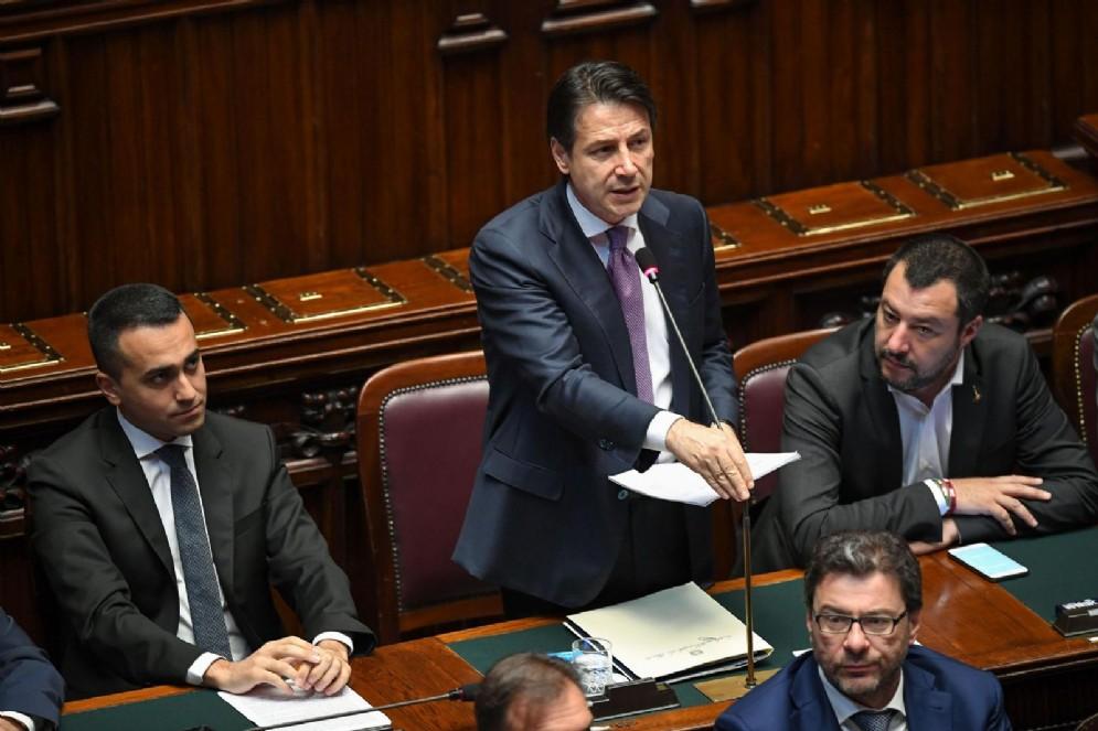 Il premier Giuseppe Conte con i vicepremier Matteo Salvini e Luigi Di Maio