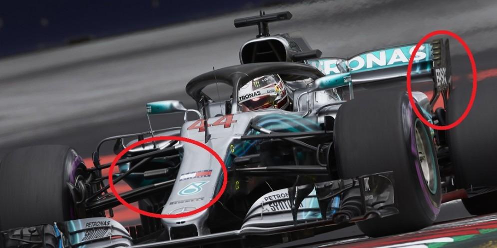 Nei cerchi rossi, le prese d'aria dei radiatori ridotte e le bandelle sulle paratie laterali dell'ala posteriore della Mercedes di Lewis Hamilton in Austria