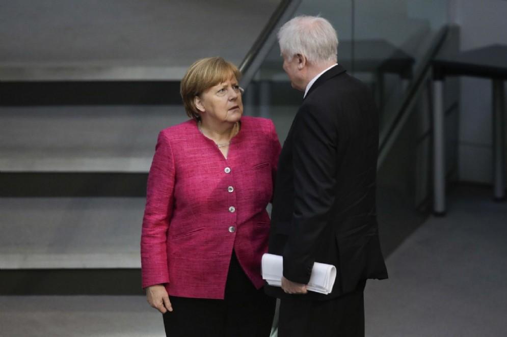 Angela Merkel con il ministro dell'Interno tedesco Horst Seehofer