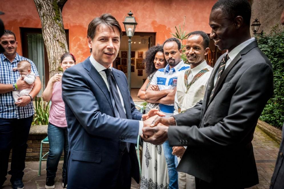 Giuseppe Conte, durante la visita alla Comunità di Sant'Egidio, Roma, 16 luglio 2018