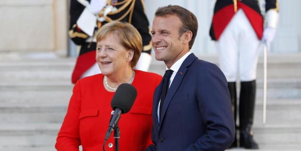 Angela Merkel con Emmanuel Macron