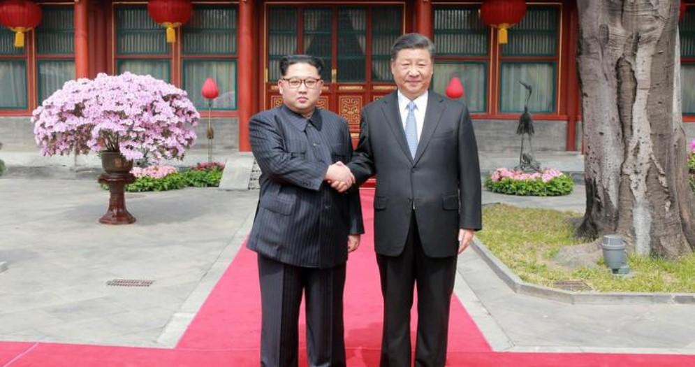 Kim Jong-Un con Xi Jinping