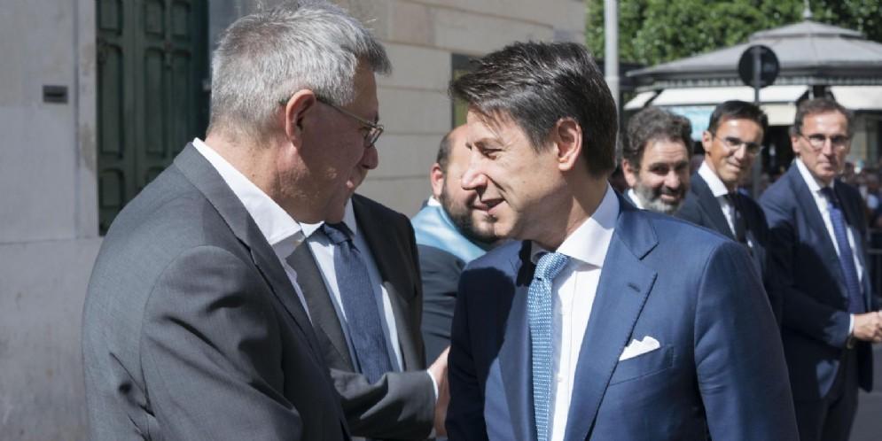 Il leader della CGIL, Maurizio Landini con il Premier Giuseppe Conte
