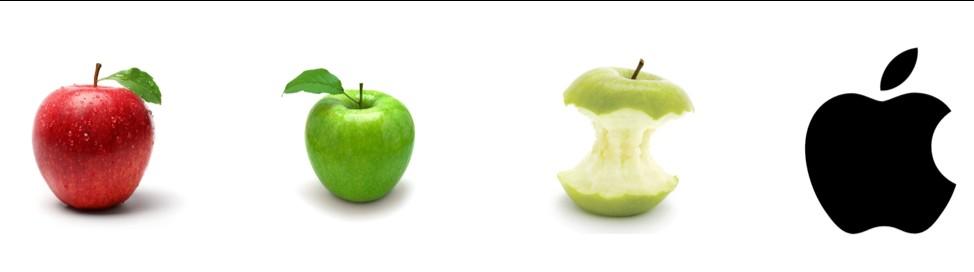 Quattro mele che dimostrano la variazione di colore e dimensioni