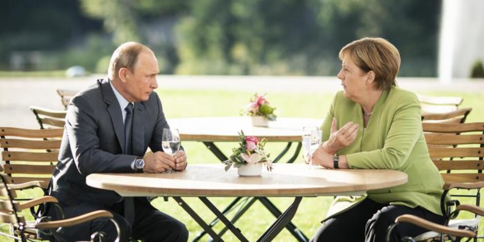 Il Presidente russo, Vladimir Putin con la Cancelliera tedesca, Angela Merkel